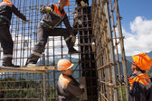 Workers make reinforcement for concrete wall — Stock Photo