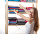 Young woman standing near the wardrobe — Foto de Stock
