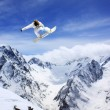 Flying snowboarder on mountains — Stock Photo #47168069