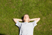 Young girl lying on the grass — Stock Photo