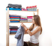 Young woman standing near the wardrobe — Stock Photo