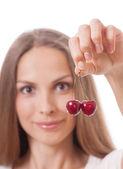 Hand holding two fresh cherries — Stock Photo