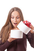 Young woman holding white round gift box — Stock Photo