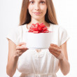 Young woman and round gift box on the table — Stock Photo