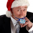 Business Santa and noisemaker — Stock Photo #6291737