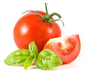 Tomato with basil — Stockfoto