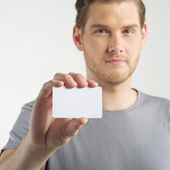 Man holding card — Stock Photo