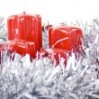 Foto Stock: Red Christmas candles and toys