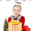Little snow maiden with gifts — Stock Photo