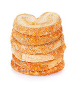 Pile of delicious cookies over white background — Stock Photo