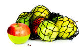 Green, red and yellow apples in in mesh bag isolated — Foto de Stock