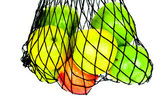 Green, red and yellow apples in in mesh bag isolated — ストック写真