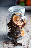 Dried oranges sealed in a jar - Christmas ornament — Stock Photo