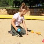 Young girl enjoys in the sandbox — Stock Photo #6300438