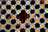 Metal old rusty lattice with flower decoration — Stock Photo