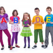 Young school children holding A B C letters — Stock Photo