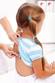 Little girl being checked at the doctor — Stock Photo