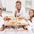 Happy morning - family having a light brekfast in bed — Stock Photo
