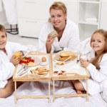 Happy morning - family having a light brekfast in bed — Stock Photo