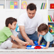 Father showing his sons a new toy — Stock Photo #12699180