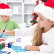 Kids making christmas greetings — Stock Photo #12699229