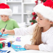 Stock Photo: Kids making christmas greetings