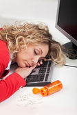 Exhausted woman asleep at work — Stock Photo