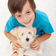 Stock Photo: Young boy with his doggy