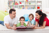 Young family story time with the kids — Stock Photo