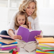 Picking a story to read with mom — Stock Photo #13613701