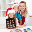 Kids with their mother making christmas cookies — Stock Photo