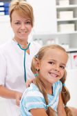 Little girl at the doctor for a checkup — Stock Photo