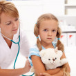 Little girl at the doctor — Stock Photo #14292715