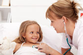 Little girl recovering - checked by doctor — Stock Photo