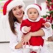 Stock Photo: Mother and baby girl celebrating christmas