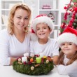Christmas time - family with advent wreath — Stock Photo