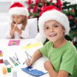 Kids making christmas greeting cards — Stock Photo