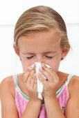 Little girl with the flu blowing nose — Foto de Stock