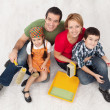 Family with two kids ready to pait their home — Stock Photo