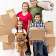 Family with two kids moving to a new house — Stock Photo #16910507