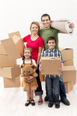 Family with two kids moving to a new house — Stock Photo