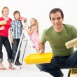 Family with kids redecorating their home - Stock Photo