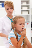 Coughing little girl on health checkup — Stock Photo