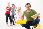 Family with kids redecorating their home — Stock Photo