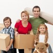 Happy family moving into a new home — Stock Photo #18798095