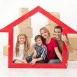 Happy family moving into a new home — Stock Photo #18798109