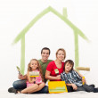 Happy couple with two kids repainting their home — Stock Photo