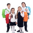图库照片: Happy school kids with colorful bags