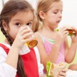 Stock Photo: Young girls having healthy snack