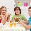Foto Stock: Kids having a snack in their room